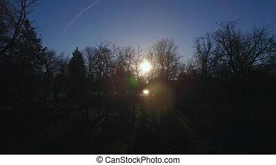Aerial view of sun shining over Buen Retiro Park in Madrid