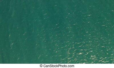 Aerial view of sunlit turquoise Mediterranean Sea