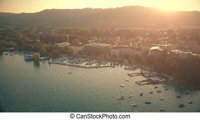Aerial view of sunlit Zurich cityscape in evening,...