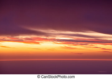 Aerial view of sunset and clouds in the sky.