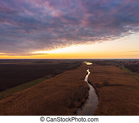 Aerial view of sunset river.