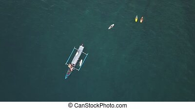 Aerial view of surfers and boat, Lombok island, Indonesia
