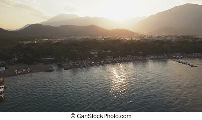 Aerial View of Swimming Boat in a Bay with Depp Blue Water. Sunset on Sea, Shot in 4K UHD