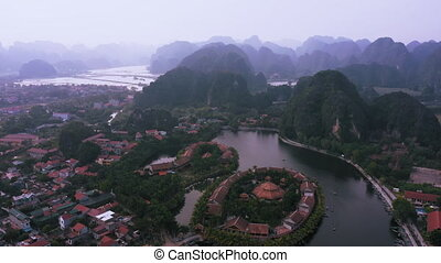 Aerial view of Tam Coc town and boat tours around Ninh Binh, Northern Vietnam
