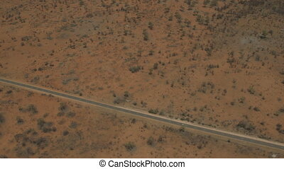 Aerial view of tarmacked Outback road, NT - Medium aerial...