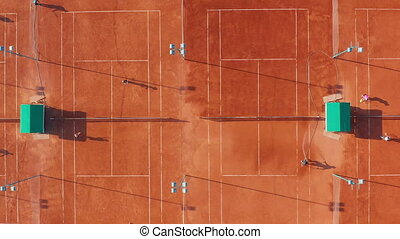 Aerial view of tennis court during a match. - Aerial view of...