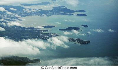 Aerial View of Thailand's Beautiful Coastline through Puffy...