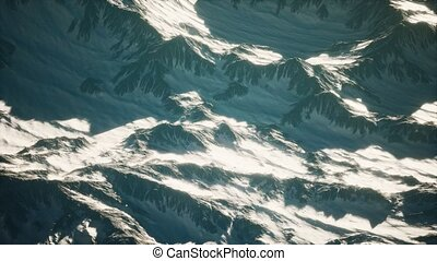 Aerial view of the Alps mountains in snow