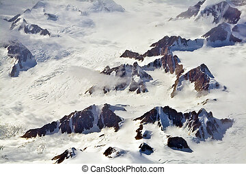 Aerial view of the antarctica with glaciers, mountain, snow...