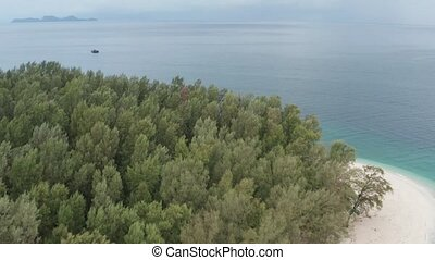Aerial view of the beautiful lagoon sea surface and tropical...