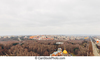 Aerial view of the Beautiful small town in early spring, park and church.