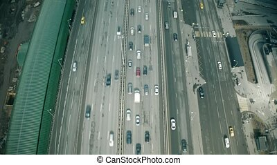 Aerial view of the beginning of a city road traffic jam in a...