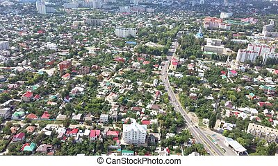 Aerial view of the big city of Russia on a sunny summer day. View of the city from a bird's eye view.