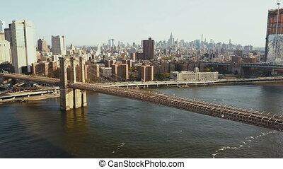 Aerial view of the Brooklyn bridge, Manhattan district in...
