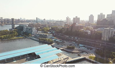 Aerial view of the Brooklyn bridge in the distance. Drone...