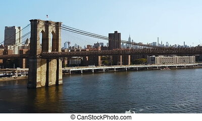 Aerial view of the Brooklyn bridge through the East river on...