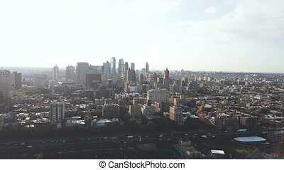 Aerial view of the Brooklyn district in the New York, America on the sunset. Drone flying over the traffic road.