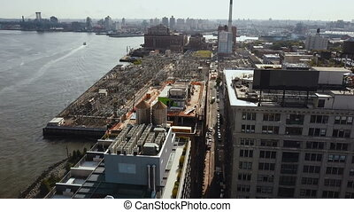 Aerial view of the Brooklyn district in New York, America. Drone flying over the building on the shore of East river.