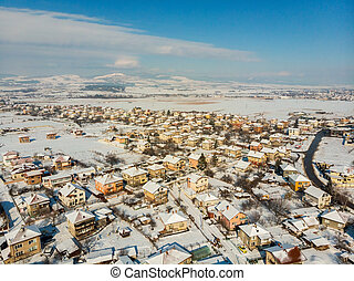 Aerial view of the bulgarian village at sunny winter day.
