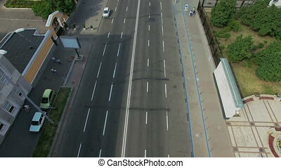 Aerial View of The Bustling Traffic on the Road at the Crossroads in Sunny Day in the Big City, Shot in 4K UHD