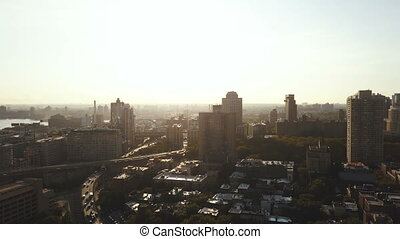 Aerial view of the busy New York, America early in the morning. Drone flying over the traffic roads in Brooklyn on dawn.