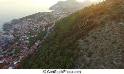 aerial view of the cableway above Dubrovnik at sunset.