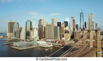 Aerial view of the capital of America. Brooklyn bridge through the East river to Manhattan in New York.