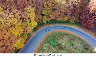 Aerial view of the car on the mountain road