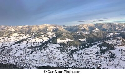 Aerial view of the Carpathian mountains in winter. Snowy landscape