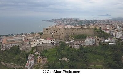 Aerial view of the Castle of Sant'Elmo in Naples. Flight of the drone over the castle overlooking the bay and city blocks.
