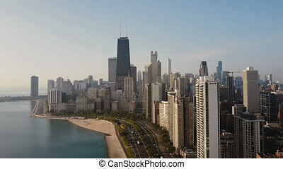 Aerial view of the Chicago, America. Drone flying up to the downtown, skyscrapers on the shore of the Michigan lake.