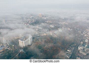 Aerial view of the city in the fog