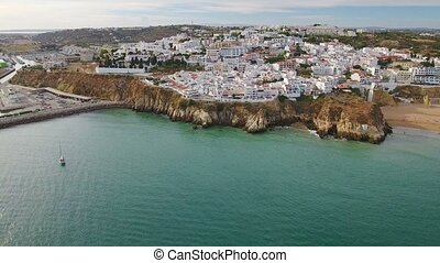 Aerial. View of the city of Albufeira and the marina from the sky.