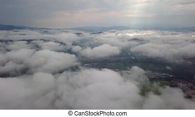 Aerial view of the city of Dolny Kubin through the clouds in Low Tatras