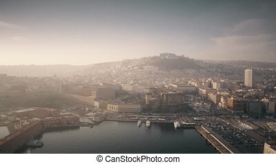 Aerial view of the city of Naples from the harbor on a hazy day. Italy