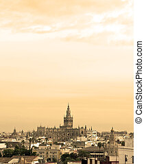 Aerial view of the city of Sevilla, are the roofs of the buildings next to Each Other, it is a cloudy day