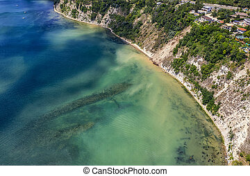 Aerial view of the coast with crystal clear seawater surface