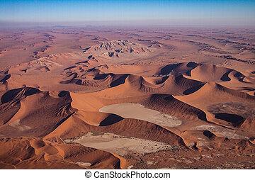 Aerial view of the coastal dunes of the Namibia Skeleton Coast.