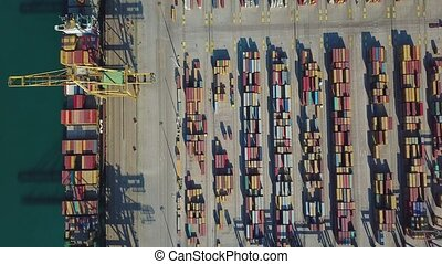 Aerial view of the commercial port of Valencia. Container terminal and ship during loading