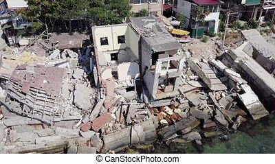 Aerial view of the consequences of a landslide in the city...