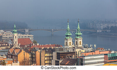 Aerial view of the Danube river in Budapest on foggy day