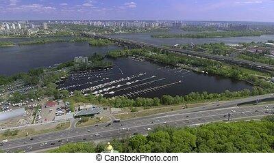 Aerial view of the Darnitskiy Bridge through the Dnipro river in Kiev, Ukraine