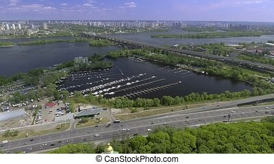 Aerial view of the Darnitskiy Bridge through the Dnipro river in Kiev, Ukraine