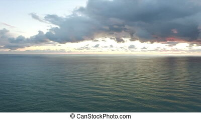 Aerial view of the dramatic sunset over the sea.