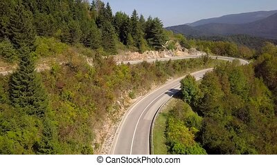 Aerial view of the empty serpentine mountain road. Croatia. Top view