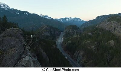 Aerial View of the Famous Scenic Drive, Sea to Sky Highway, during a sunny sunset. Located between Squamish and Whistler, North of Vancouver, British Columbia, Canada.