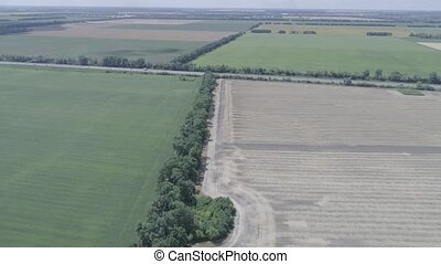 Aerial view of the fields and the road in foreground