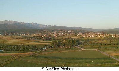 Aerial view of the fields near Sinj and river Cetina - Hay...