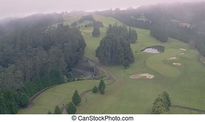 Aerial View of the Golf Course in Mountains - Aerial View of...