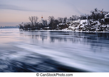 Aerial view of the great river with floating ice floes during the dusk. Drifting of ice. Ice floe. motion blur. II